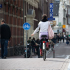 Girl on bicycle in the city