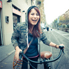 Girl smiles on bicycle